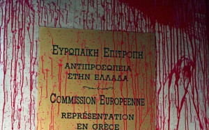 Red paint covers the entrance to European Union offices in Athens on April 23, 2015. European governments have come under increasing pressure to tackle the Mediterranean migrant crisis, with the last shipwreck claiming hundreds of lives on April 19, 2015. AFP PHOTO / LOUISA GOULIAMKI / RMALOUISA GOULIAMAKI/AFP/Getty Images