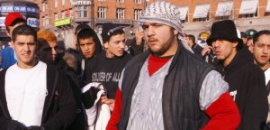 Disgruntled Muslim protesters gather on City Hall Square in Copenhagen, Denmark Saturday Feb. 4, 2006. Denmark, a small country that prides itself on extensive humanitarian work and that usually gets only cursory media attention suddenly finds itself denounced as evil for publishing 12 cartoons of the Prophet Muhammad. Muslims in Denmark _ some 200,000 of the country's 5.4 million people _ complain of being discriminated against and being denied jobs.  (AP Photo/John McConnico)